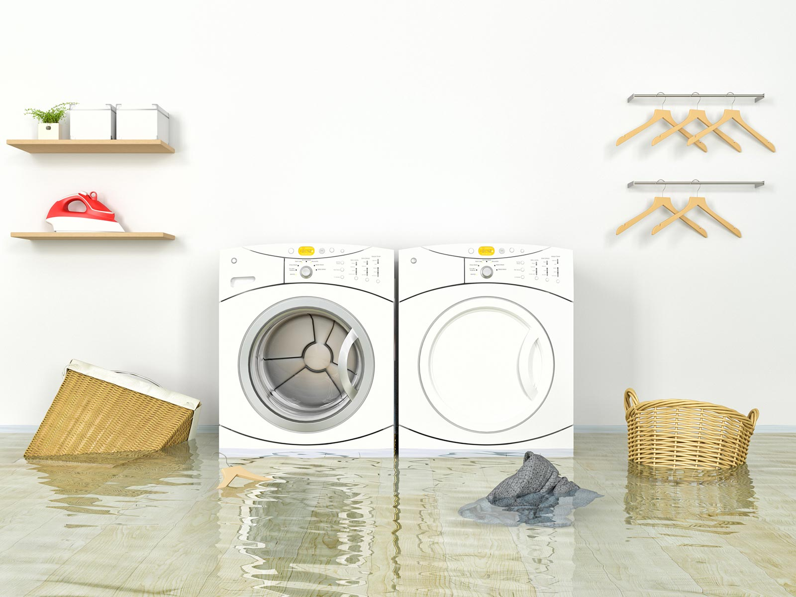 Flooded laundry room, washer and dryer